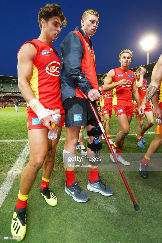 The injured Peter Wright of the Suns walks off during the round 20 AFL match between the Melbourne Demons and the Gold Coast Suns at Melbourne Cricket Ground on August 5, 2018 in Melbourne, Australia.