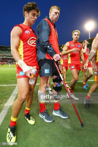 The injured Peter Wright of the Suns walks off during the round 20 AFL match between the Melbourne Demons and the Gold Coast Suns at Melbourne...