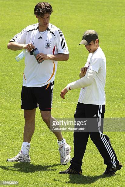 The injured player Philipp Lahm talks with Michael Ballack during the training camp of the german national football team day four on May 20 2006 in...