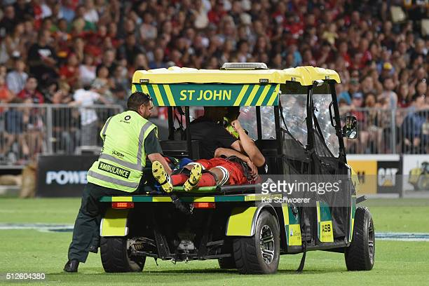 The injured Reed Prinsep of the Crusaders is brought off the pitch by St John Ambulance during the round one Super Rugby match between the Crusaders...
