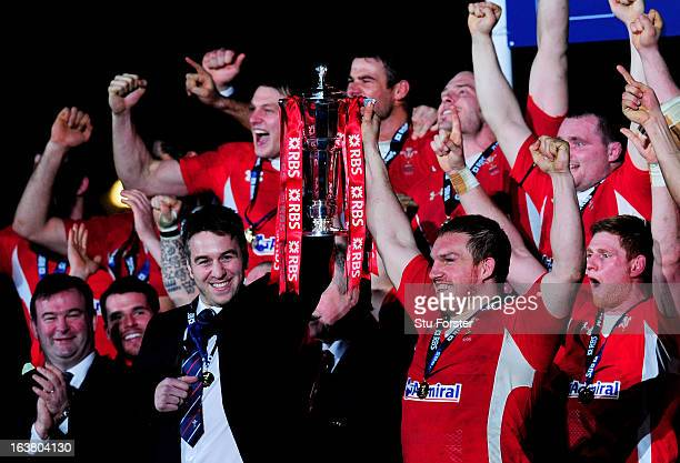The injured Ryan Jones and Gethin Jenkins of Wales lift the Six Nations Championship trophy following their team's victory during the RBS Six Nations...
