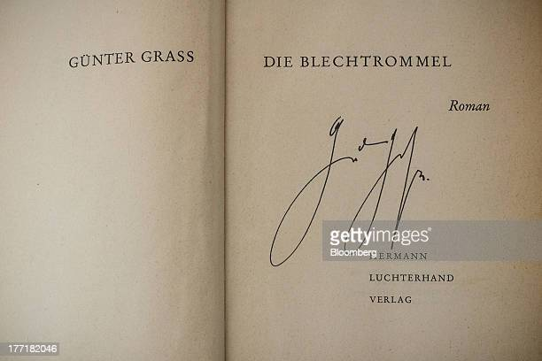 The inner front pages of an original firstedition signed copy of 'The Tin Drum' belonging to the mother of Manuela Hoelterhoff executive editor of...