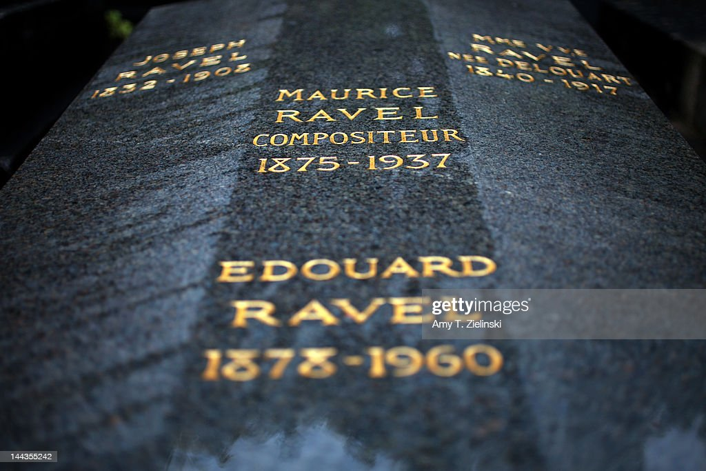 The inscribed granite gravestone of French composer Maurice Ravel (1875 - 1937) at Levallois-Perret Cemetery, in the northwestern suburbs of Paris, 25th April 2012. Ravel is buried with his parents.