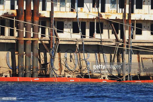 The inscription Concordia is visible from the submerged port side of the wrecked cruise ship as it sits in the water after the first stage of the...