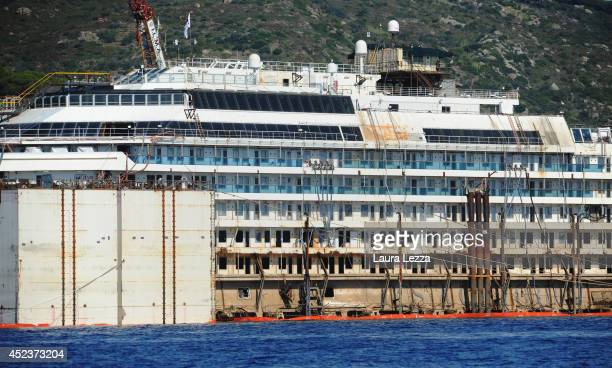 The inscription Costa Concordia is visible from the submerged port side of the wrecked cruise ship as it sits in the water after the first stage of...