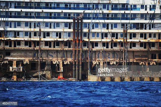 The inscription Costa Concordia is visible from the submerged port side of the wrecked cruise ship as it sits in the water during the last stage of...