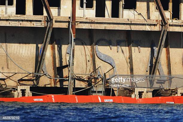 The inscription Costa is visible from the submerged port side of the wrecked cruise ship as it sits in the water after the first stage of the...