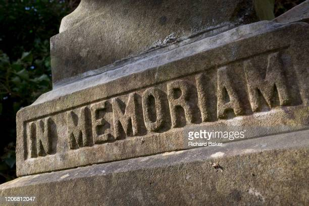 The inscription 'In Memoriam' is written at the base of a statue artwork located in the Victorian cemetery at Nunhead in south London on 1st march...