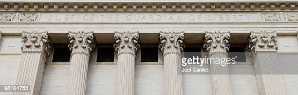 inscription on back of supreme court - legal system stock pictures, royalty-free photos & images