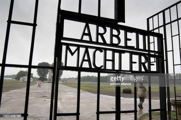 The inscription on the entrance gate reads 'Arbeit macht frei' at the Sachsenhausen Memorial in Oranienburg Germany 26 July 2017 Photo Soeren...
