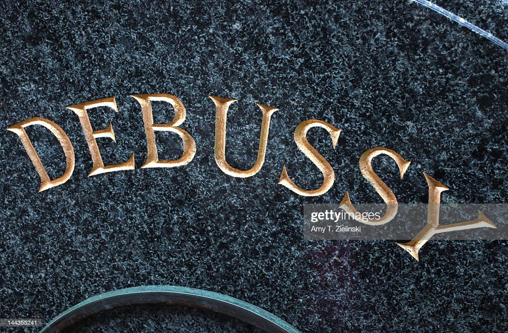 The inscription on the gravestone of French composer Claude Debussy (1862 - 1918) at Passy Cemetery in Paris, 25th April 2012. Debussy's wife Emma Bardac and daughter Claude-Emma are buried with him.