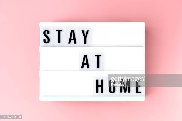 the inscription on the lightbox stay home - lightbox stock pictures, royalty-free photos & images