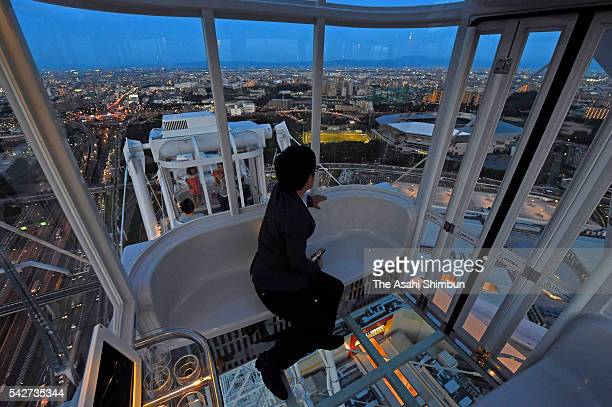 The inside of a transparentfloored gondola of the Redhorse Osaka Wheel is seen during the press preview at the Expocity on June 23 2016 in Suita...