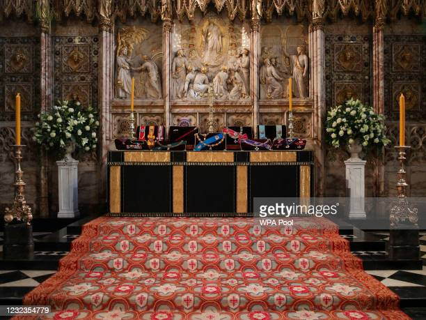 The insignia belonging to Prince Philip, Duke of Edinburgh is placed on the altar at St George's Chapel ahead of the funeral of Prince Philip, Duke...