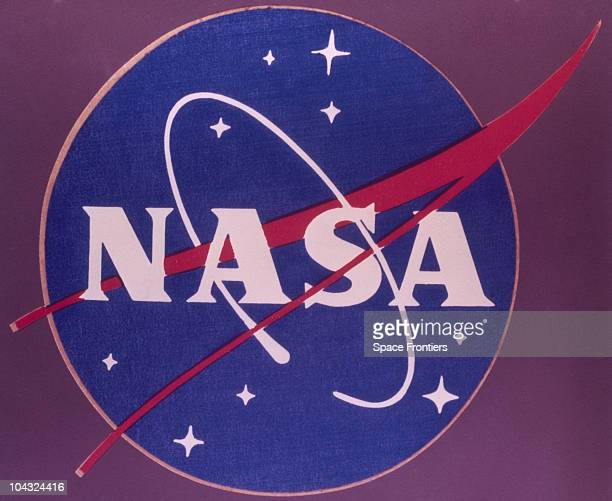The insignia of the National Aeronautics and Space Administration , circa 1970. It feaures a starry sky with a red vector or chevron and an orbiting...