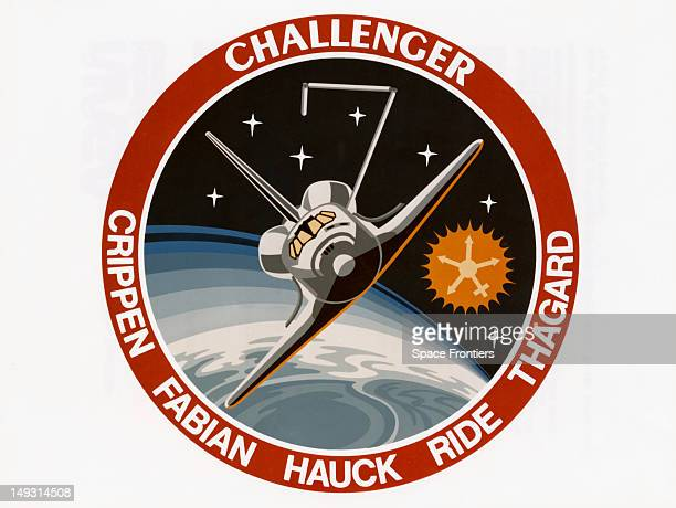 The insignia of the STS7 NASA mission showing the space shuttle Challenger in orbit 1983 The remote manipulator arm forms the number 7 On this...