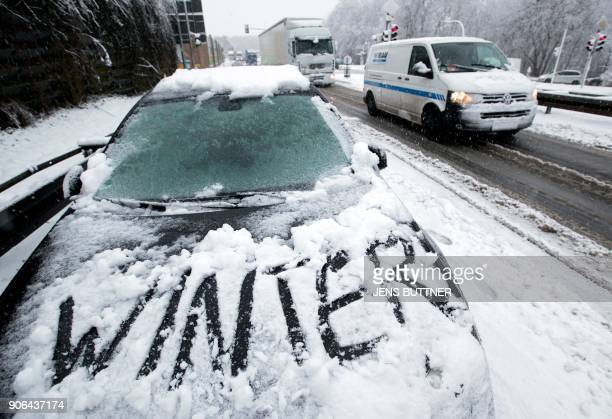 The insription 'winter' has been written on the snow on a parked car in Bruesewitz near Schwerin eastern Germany on January 18 2018 Weather forecasts...