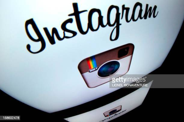 The Instagram logo is displayed on a tablet on December 20 2012 in Paris Instagram backed down on December 18 2012 from a planned policy change that...