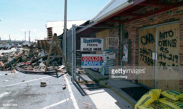 The insurance company and policy numbers of a feed store partially destroyed by Hurricane Charley are written on the door in Arcadia Florida August...