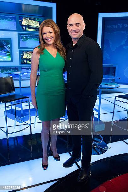 'The Intelligence Report' host Trish Regan poses with Andre Agassi during his visit to FOX Business Network at FOX Studios on September 10 2015 in...