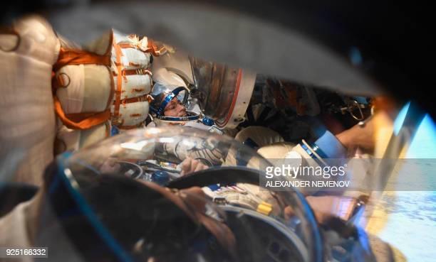 TOPSHOT The Intenational Space Station crew members Russian cosmonaut Alexander Misurkin and NASA astronauts Mark Vande Hei and Joe Acaba are seen...