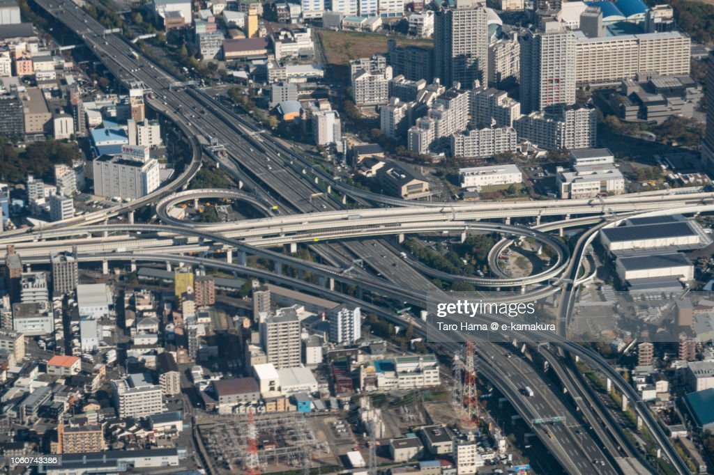 The interchange of Hanshin Expressway and Kinki Expressway in Higashiosaka city in Osaka prefecture in Japan daytime aerial view from airplane : ストックフォト