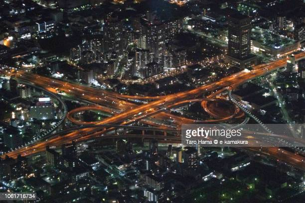 The interchange of Hanshin Expressway and Kinki Expressway in Higashiosaka city in Osaka prefecture in Japan night time aerial view from airplane