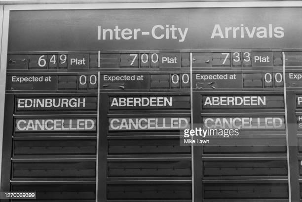 The inter-city arrivals board at King's Cross railway station in London, during a period of industrial action, 17th January 1985. The trains from...