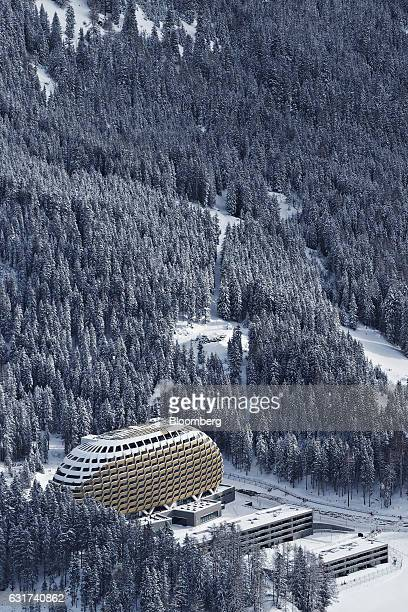 The InterContinental hotel Davos operated by InterContinental Hotels Group Plc seen from Parsenn mountain sits between snow covered trees in Davos...