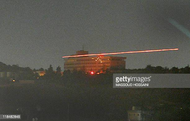 The InterContinental hotel in seen in the dark as tracer bullets are shot during an attack in Kabul on June 29 2011 Witnesses reported hearing two...