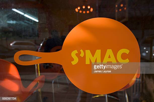 The interior and window signage of S'MAC a new macaroni and cheese restaurant which has opened on E 12th Street