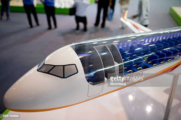 The interior cabin seating of a cutaway model of a Commercial Aircraft Corp of China ARJ21 aircraft sits on display at the China International...