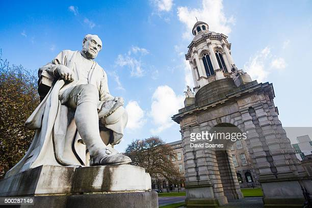 CONTENT] The interior courtyard of Trinity College Dublin with a statue and a Campanile