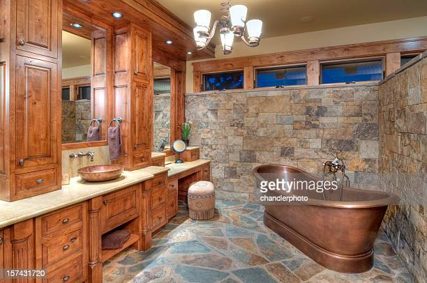 The interior of a bathroom with a copper tub