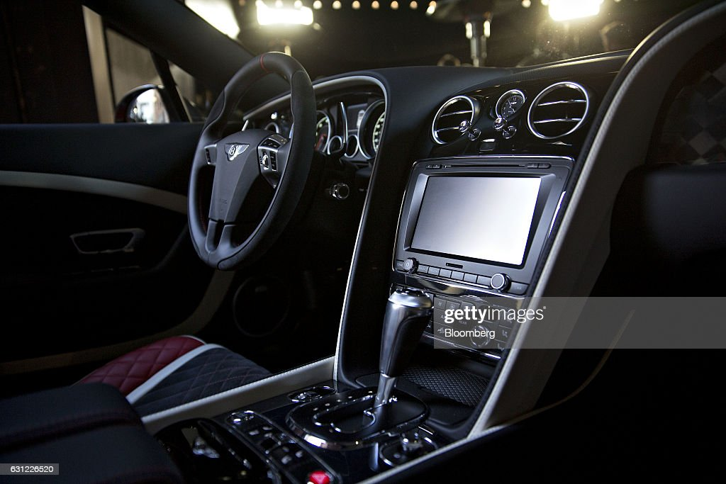 The interior of a Bentley Motors Ltd. 2017 Continental Supersports convertible vehicle sits on display during a reveal event ahead of the 2017 North American International Auto Show (NAIAS) in Detroit, Michigan, U.S., on Sunday, Jan. 8, 2017. The 2017 Continental Supersports, Bentley's fastest, most powerful production Bentley ever, is the third iteration of the Supersports model that Bentley first produced in the 1920's and reintroduced in 2009. Photographer: Andrew Harrer/Bloomberg via Getty Images