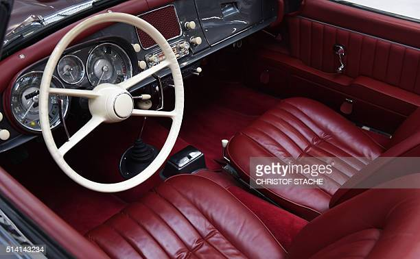 The interior of a BMW vintage car presented in a former production hall of the German car maker is pictured prior to celebrations to mark BMW's 100th...