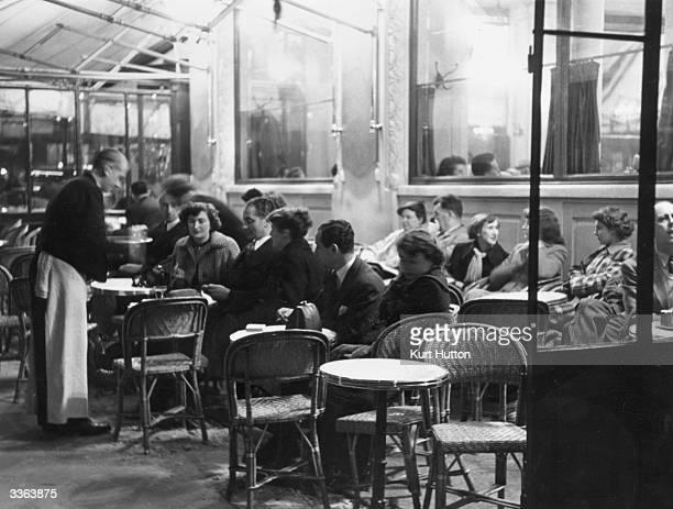 The interior of a cafe in Paris Original Publication Picture Post 5436 Paris Theatre unpub
