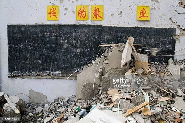 The interior of a classroom is revealed by the destruction. The searches are over at Juyuan school were 900 people were traped after the monday's...