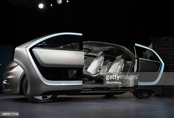 The interior of a Fiat Chrysler Automobiles NV Portal concept minivan vehicle is seen during the 2017 Consumer Electronics Show in Las Vegas Nevada...