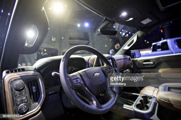 The interior of a General Motors Co 2019 Chevrolet Silverado pickup truck sits on display during the 2018 North American International Auto Show in...
