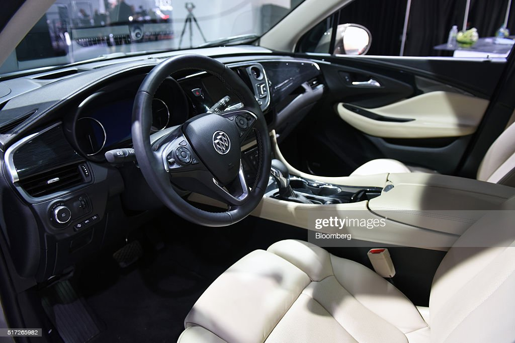 The interior of a General Motors Co. Buick Envision sports utility vehicle (SUV) is seen during the 2016 New York International Auto Show in New York, U.S., on Thursday, March 24, 2016. Nearly 1,000 cars and trucks will be on display at North America's first and largest-attended auto show. Photographer: Ron Antonelli/Bloomberg via Getty Images