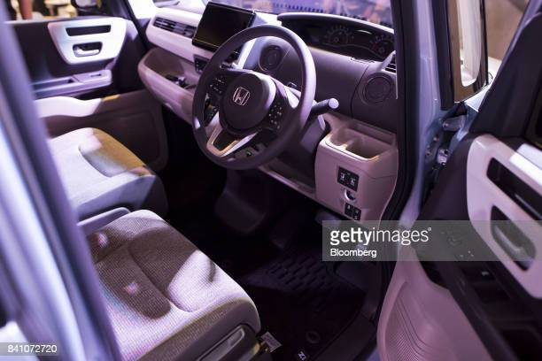 The interior of a Honda Motor Co. N-Box minicar is seen during a media preview in Tokyo, Japan, on Tuesday, July 4, 2017. Honda will start to sell...