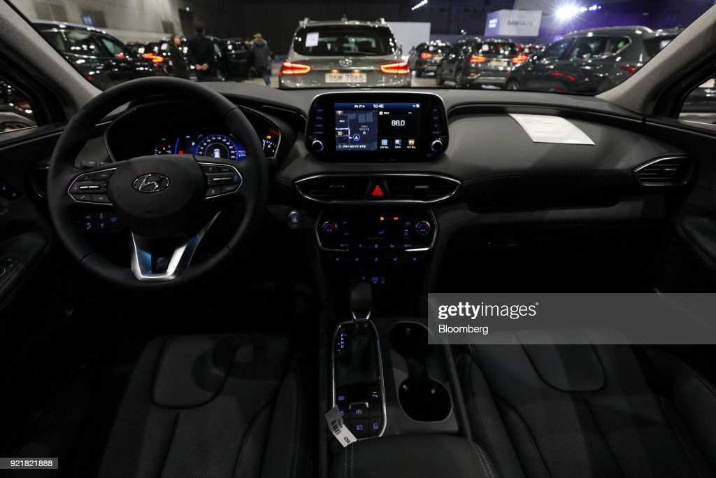 The interior of a Hyundai Motor Co. Santa Fe sport utility vehicle (SUV) is seen during a launch event for the updated vehicle in Goyang, South Korea, on Wednesday, Feb. 21, 2018. To recapture buyers in the U.S. who have shunned its sedans and compact cars, Hyundai has said it will bring eight new or redesigned crossovers or SUVs by 2020. Photographer: SeongJoon Cho/Bloomberg via Getty Images