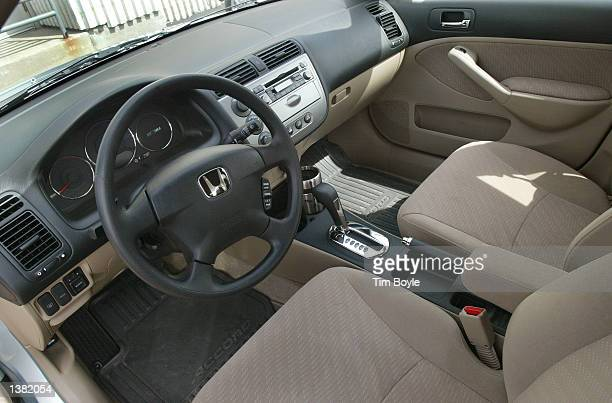 The interior of a new 2003 Honda Civic Hybrid vehicle is seen in the showroom of O'Hare Honda September 13, 2002 in Des Plaines, Illinois. The...