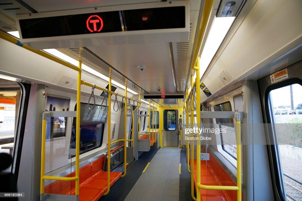 The interior of a new MBTA Orange Line car at Wellington