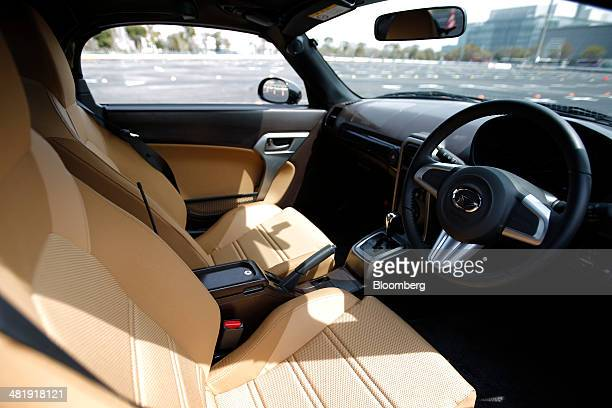 The interior of a prototype of a Daihatsu Motor Co Copen convertible sports minicar is seen during a media preview in Tokyo Japan on Tuesday April 1...