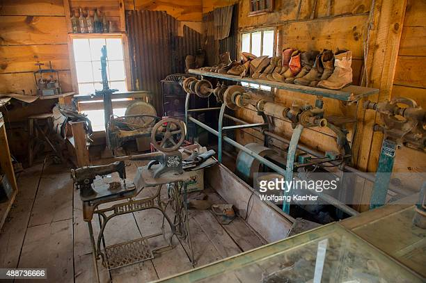 The interior of a shoemaker shop with an old Singer sewing machine at the historic Gold King Mine and Ghost Town from the 1890s outside of Jerome in...
