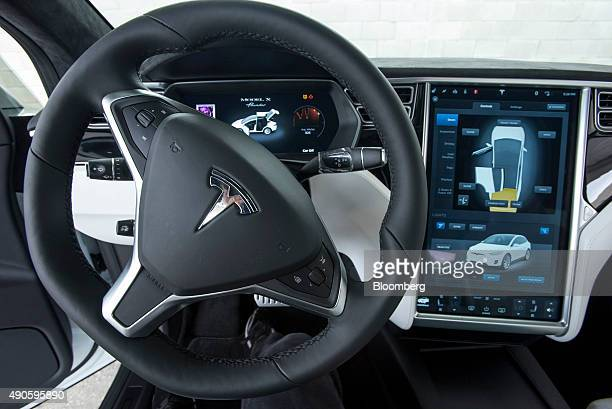 The interior of a Tesla Motors Inc Model X sport utility vehicle is displayed during an event in Fremont California US on Tuesday Sept 29 2015 Elon...
