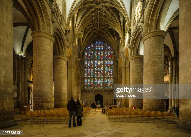 The interior of Gloucester Cathedral with its stained glass West window.