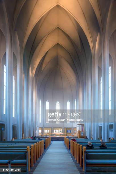 the interior of hallgrimskirkja cathedral, reykjavik, iceland - church stock pictures, royalty-free photos & images